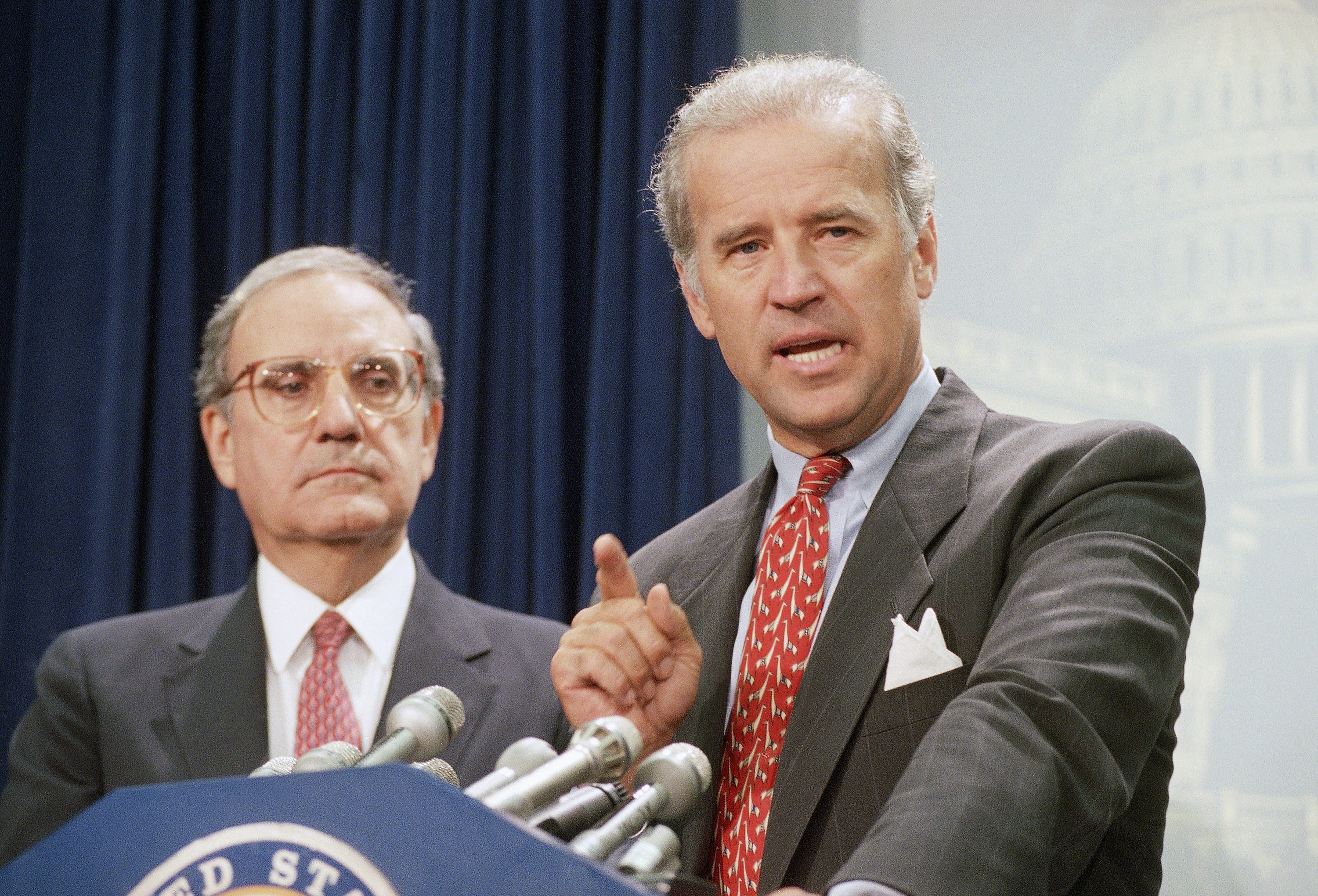 Sen. Joe Biden, D-Del., right, accompanied by Senate Majority Leader George Mitchell of Maine, at a Capitol Hill news conference on Aug. 25, 1994, after the Senate voted to push the $30 billion crime bill.