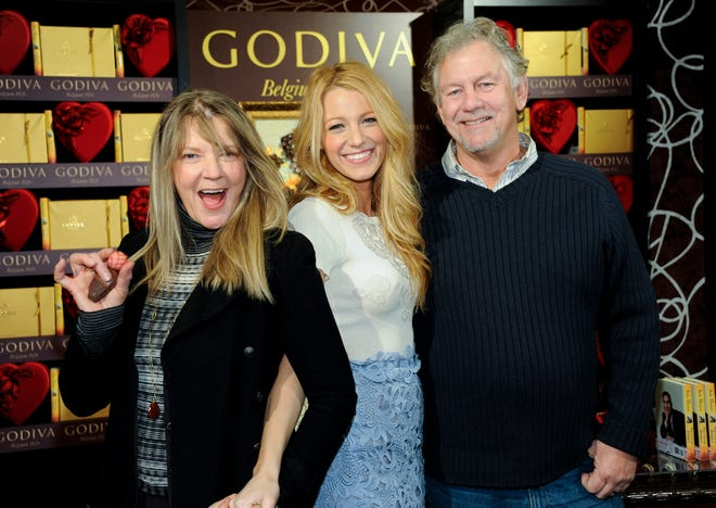 Actress Blake Lively, center, poses with her parents Elaine and Ernie Lively at a Godiva press event on Wednesday, Feb. 1, 2012 in New York.