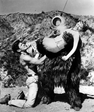 """A scene from the 1953 movie """"Robot Monster,"""" starring George Nader and Claudia Barrett."""