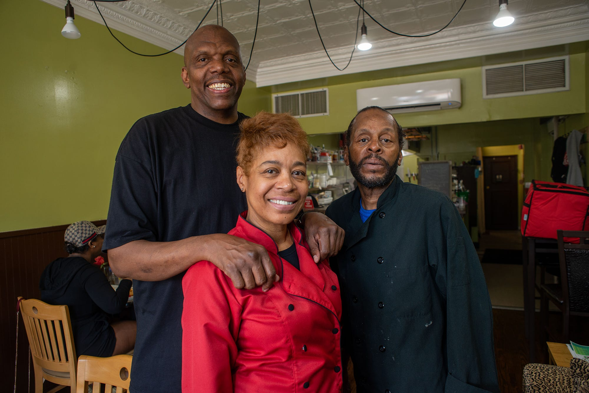 From left, John Taylor, Stephanie Taylor and Chef Dawud Lee at Welcome Home Café on June 9, 2021, in Jenkintown, Pa.