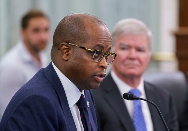 Howard University President Wayne Frederick, left, joined NCAA President Mark Emmert, right, and four others giving testimony Wednesday on name, image and likeness to the Senate Commerce Committee.