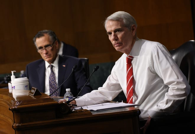 Sen. Mitt Romney, R-Utah, and Sen. Rob Portman, R-Ohio, attend a Senate Foreign Relations Committee hearing on U.S. policy towards Belarus at the Dirksen Senate Office Building on Wednesday in Washington.