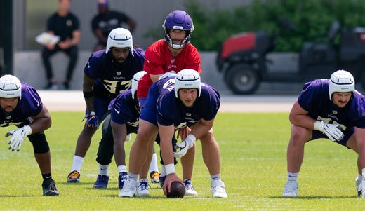 Kirk Cousins leads the Minnesota Vikings offense in drills at TCO Performance Center on June 9.