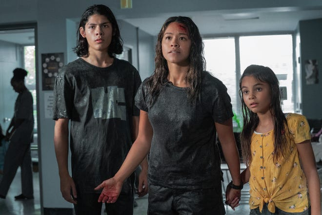 """Gina Rodriguez (center) plays a mom keeping her kids (Lucius Hoyos and Ariana Greenblatt) safe amid a mysterious apocalypse in """"Awake."""""""