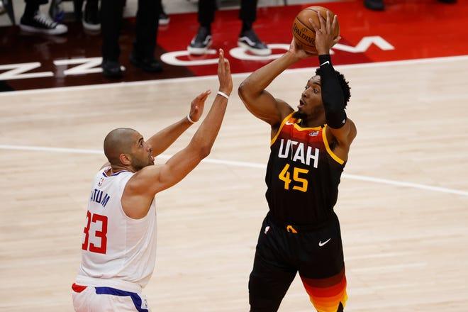 Jazz guard Donovan Mitchell (45) shoots over Clippers forward Nicolas Batum (33).