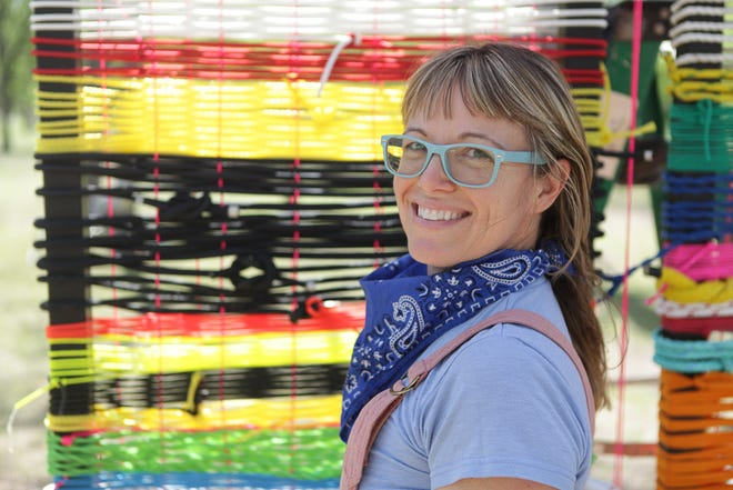 """Artist Jade Walker in front of a portion of """"Mire + Mend,"""" part of her """"Reweave: 2021"""" at the Elisabet Ney Museum."""