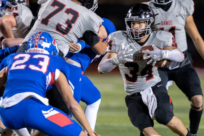 Bowie running back Noah Camacho looks for more yards past Hays defensive back Chris Bruce in a game last season. A 5-foot-8, 200-pound bowling ball of a runner, Camacho rumbled for 653 yards and three touchdowns on 116 carries a year ago and could serve as the backfield bell cow