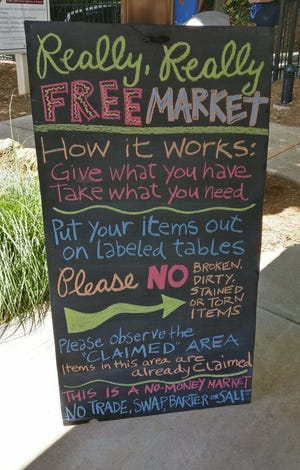This February 2020 photo shows the sign at Athens Really Really Free Market at Reese and Pope Park in Athens, Ga.