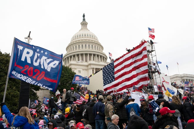 In this Jan. 6  photo, supporters of President Donald Trump besiege the U.S. Capitol in Washington.