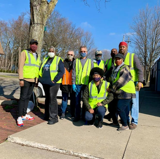 Weekly cleanups continue in the Maple Valley area off Copley Road in West Akron after community groups organized volunteers in August, 2020. From left, Great Streets Akron coordinator Mark Greer, Maple Valley Merchants Business Association president Fannette Morris, Terry and Susan Yinglings, Angelo Johnson, James and Karen Reddick, and Jaylon Smith, in front.