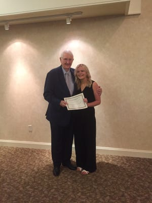 Stephen A. Douglas, Jr. on behalf of the Douglas Family Trust, presented a scholarship certificate and check from the Jane Douglas Nursing Scholarship Fund to Madelynn Thomas to use for tuition when she attends school this fall at the Southern Tech in Ardmore.
