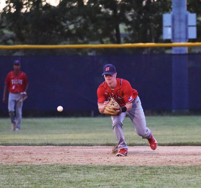 Ballard shortstop Sam Petersen charges a grounder during the Bombers' 11-4 comeback win over No. 4 Gilbert June 9 at Nite Hawk Field in Slater. The Bombers score 10 runs in the sixth inning to pull off the upset.