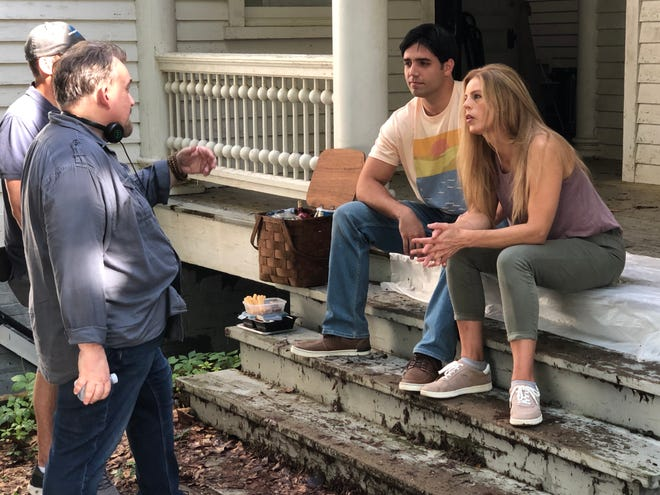 """Director Robert Hollocks (left) discusses an upcoming scene for the movie """"Applewood"""" with actors John Grove and Kate Dailey during filming Tuesday at a house in Augusta."""