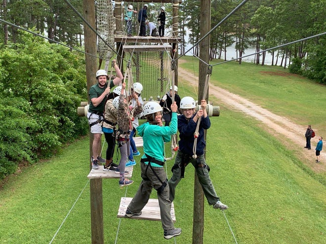 Scouts from Troop 2319 complete the ropes course at Pointes West in Appling.