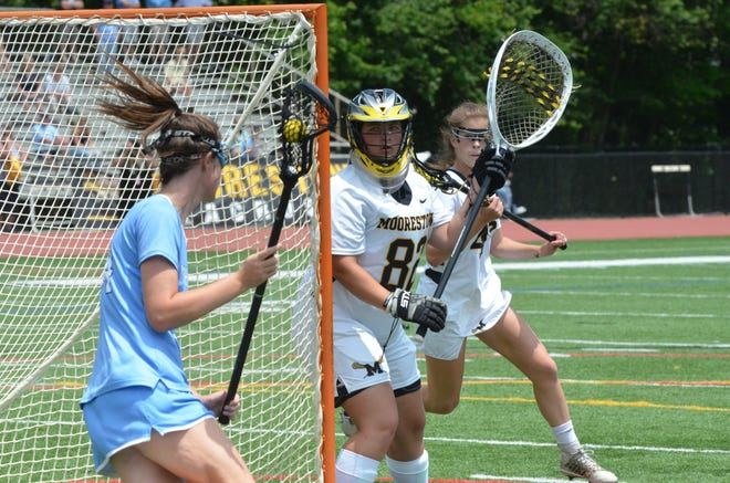 Moorestown senior goalie Haley Kowalczyk eyes up Shawnee sophomore Abby Catalano