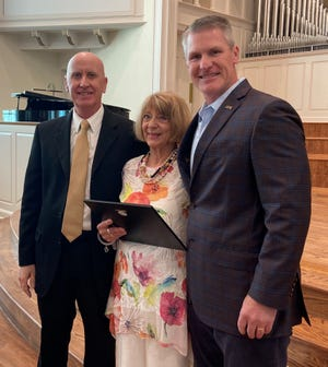 Pictured at a ceremony announcing the Diane Owens Excellence in Music Education Scholarship are Dr. Richard Fiese, dean of the HPU School of Music and Fine Arts; Diane Owens, director of the Pre-College Music Program; and Dr. Dale Meinecke, vice president for development at HPU.