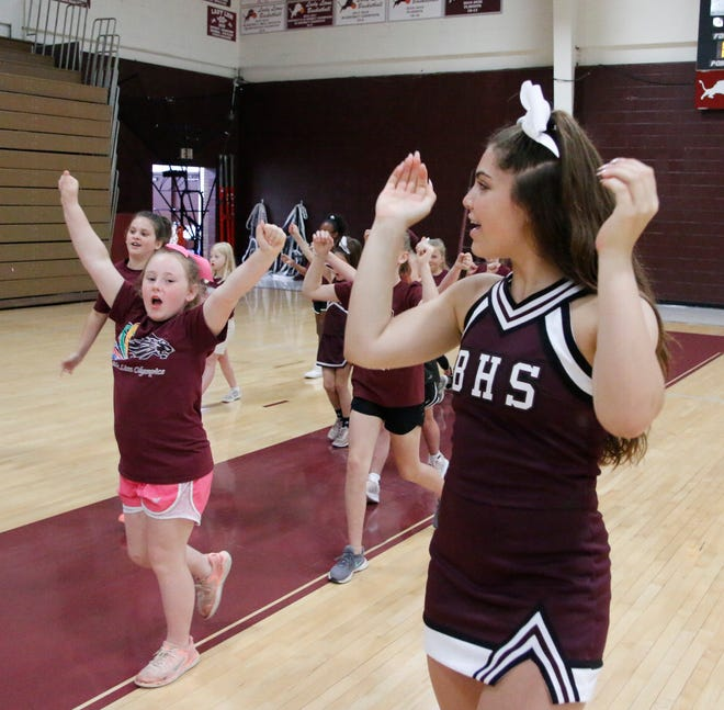 Brownwood High School cheerleader Jaslin Jones encourages a group of campers Wednesday at the three-day mini-cheer camp in the high school gym. The camp, for girls ages five through fifth grade, drew 85 participants.