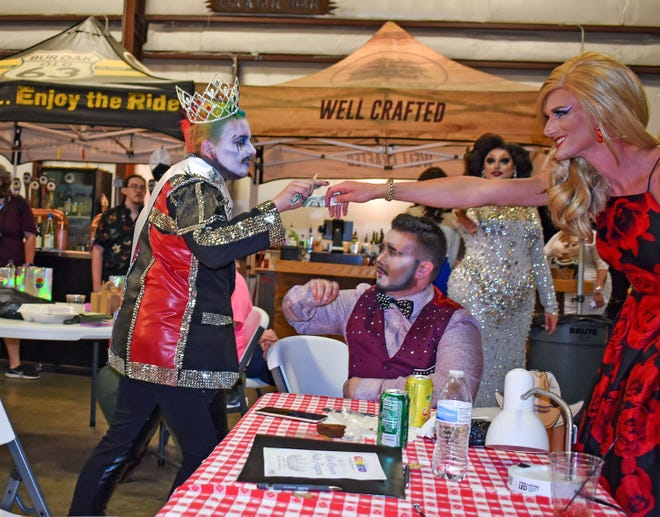 Ezra Prince, left, performs after being crowned as the Mid-MO Pridefest King during the Mid-MO Pride Pageant on June 4 at Burr Oak Brewery. The event was a precursor to the Mid-MO Pridefest in August at Rose Music Hall.