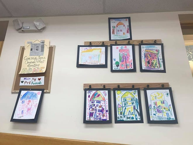 """Students in Pam Grabosky Smith's Penn Yan Elementary's  Pre K art class created their depictions of what 'Home' means to them. Their art work is on display at the Penn Pan Public Library during the month of June as part of the Penn Yan Action Coalition's 2021 Community Read, """"Home Now."""""""