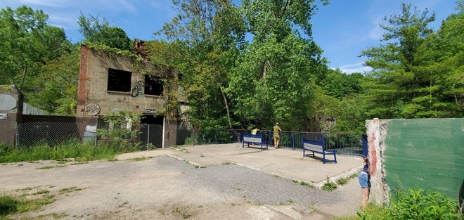 Condemned and beyond repair, the buildings of the old Cascade Mill on the Keuka Outlet are to be razed this summer and the site enhanced for its natural beauty.