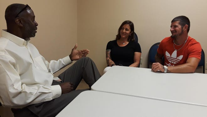 Clarence McGuire, treatment director of the Terrebonne Parish Drug Court, discusses the program with former clients Jennifer Hollahan and Cody Chauvin in 2019.