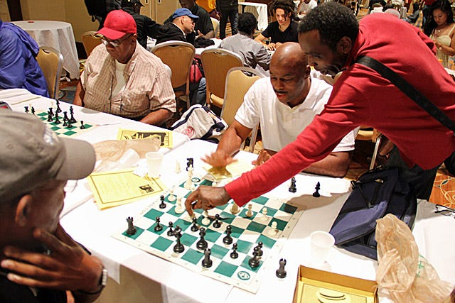 In this file photo, William Morrison analyzes his win over six-time women's champion, grandmaster Irina Krush. Young players will get to compete against and learn from Morrison today and Friday as part of a two-day tournament in Asheboro.