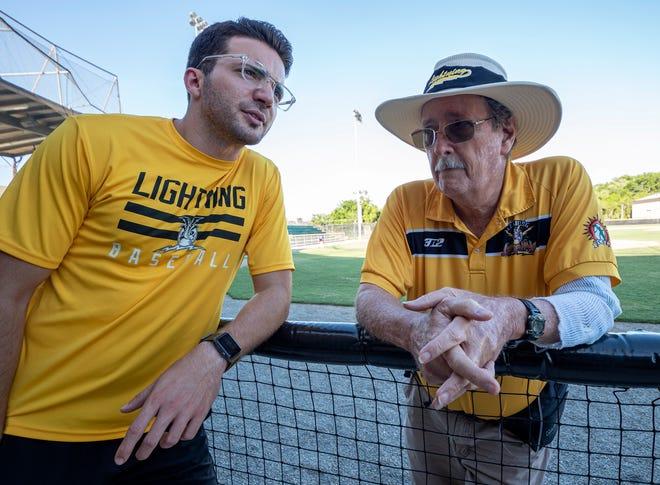 Leesburg Lightning team president Tyler Brandeburg, left, and John Meier talk over game day activities before Wednesday's game at Pat Thomas Stadium-Buddy Lowe Field. [PAUL RYAN / CORRESPONDENT]