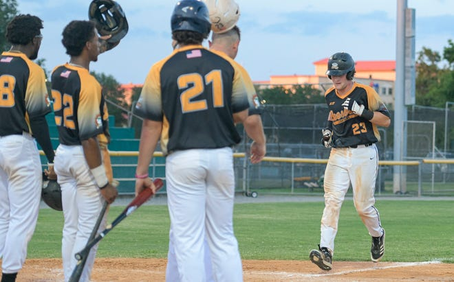 Leesburg's Clay Stearns (23) completes his trip around the bases after hitting a grand slam at a game between the Leesburg in Wednesday's game against the Winter Garden Squeeze at Pat Thomas Stadium-Buddy Lowe Field. [PAUL RYAN / CORRESPONDENT]