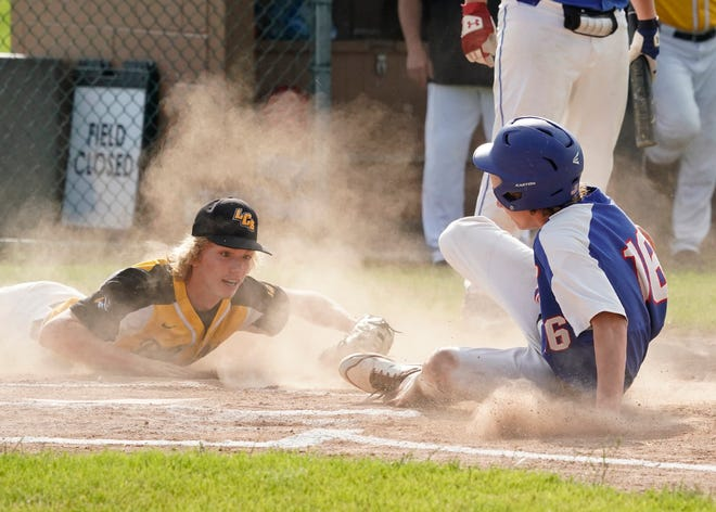Lenawee Christian's Andrew Campbell avoids a tag from Lansing Christian's Jackson Titus during Wednesday's Division 4 regional final at Lenawee Christian.