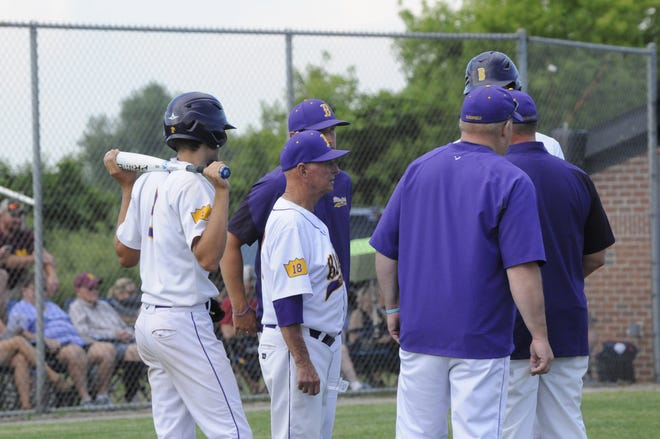 Blissfield head coach Larry Tuttle talk with coaches and players before an at-bat during Wednesday's Division 3 regional semifinal against Manchester at Clinton.