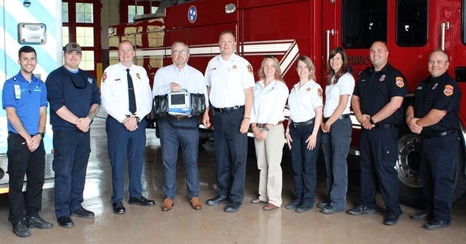 Pictured from, left to right, with the new Zoll X-series monitor are Maury Regional AEMT Frank Lanotte and Paramedic William Miles; Maury Regional EMS Director Brian Hupp; Foundation Executive Director Joe Kilgore; CFR Chief Ty Cobb; Maury Regional EMS Community Health Manager Kimberly Markgraf; CFR Community Risk Reduction Coordinator Hanna Miller; Maury Regional EMS Assistant Director Amanda Schatz; and CFR Firefighters Will Craft and Joey Norman.