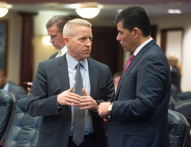State Rep. Paul Renner speaks with former House Speaker Jose Oliva inside the Florida Capitol in Tallahassee in an undated photo.