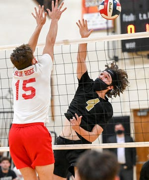 Western Wayne's Matt Henneforth soars high above the net during late-season Lackawanna League boys volleyball action. The senior middle hitter has been named 2021 Most Valuable Player.