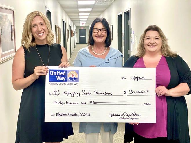 ACUW Director Amanda Joyce-Phelps, left, presents a $30,000 check for the Allegany Senior Foundation to Reita Sobeck-Lynch and Anita Mattison.