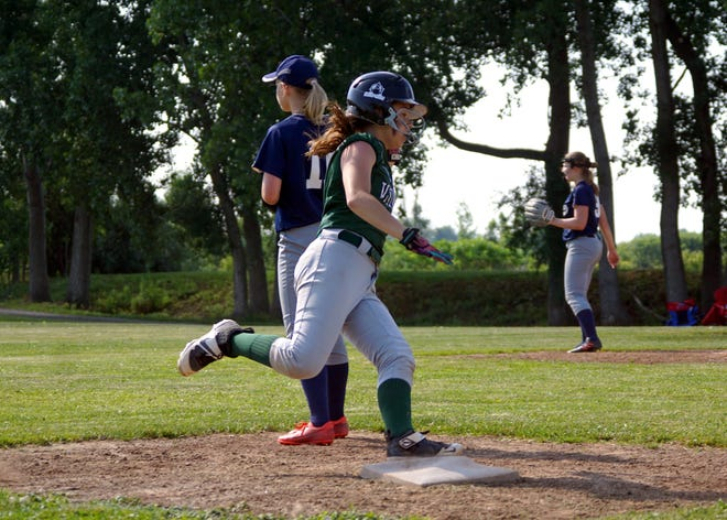 Avoca-Prattsburgh's Emma Carlton rounds third base and heads for home in Wednesday's playoff win over Lima Christian.