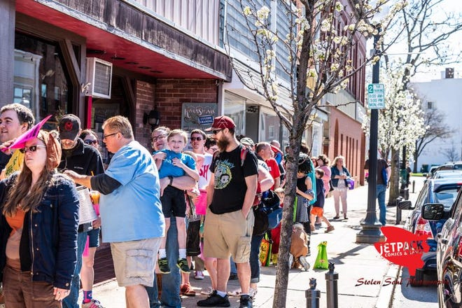 Event attendees walk from business to business, taking advantage of a variety of special offerings and the opportunity to collect one free comic book per family at each stop.