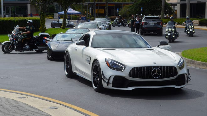 A Mercedes-AMG and Lamborghini lead the pack with police escorts as the annual Highway To Help Heroes scenic ride kicked off at Ring Power in St. Augustine