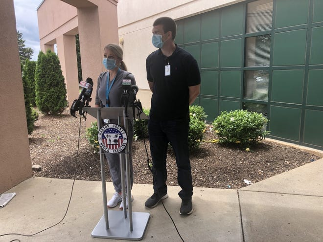 Health Department data analyst Kyle Gamble and communicable disease nursing supervisor Ellen Wright speak recently about a Hepatitis A outbreak in the Gaston County.