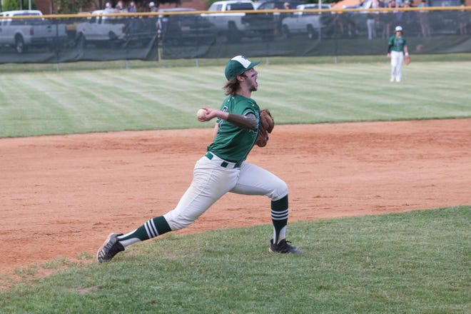 East Henderson's Cooper Wilmot fields the ball at third for the Eagles during a game against Pisgah earlier this season at East.
