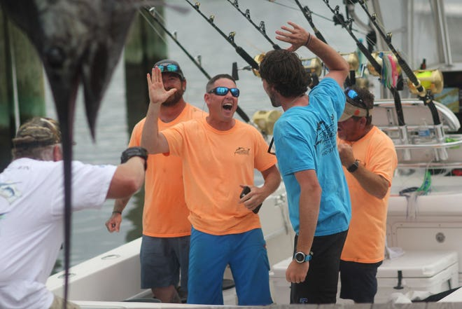 The Sneads Ferry boat Pelagic Hunter II, a 35-foot Contender, won last year's Big Rock Blue Marlin tournament. [Chris Miller / The Daily News]