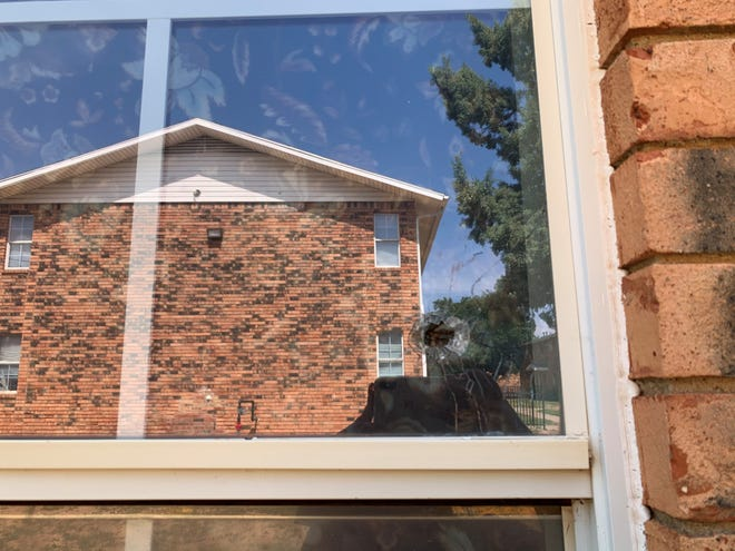 Bullet damage was visible in a window of an apartment unit at Ella Apartments Thursday in Central Lubbock.