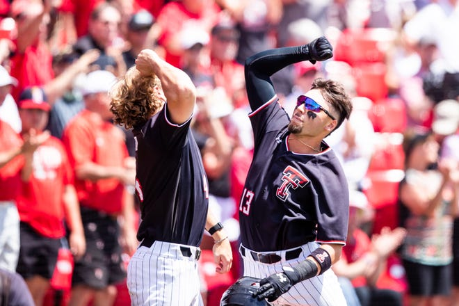 Texas Tech's Cal Conley celebrates with Dru Baker during an NCAA Lubbock regional game June 4, 2021 against Army at Dan Law Field at Rip Griffin Park.