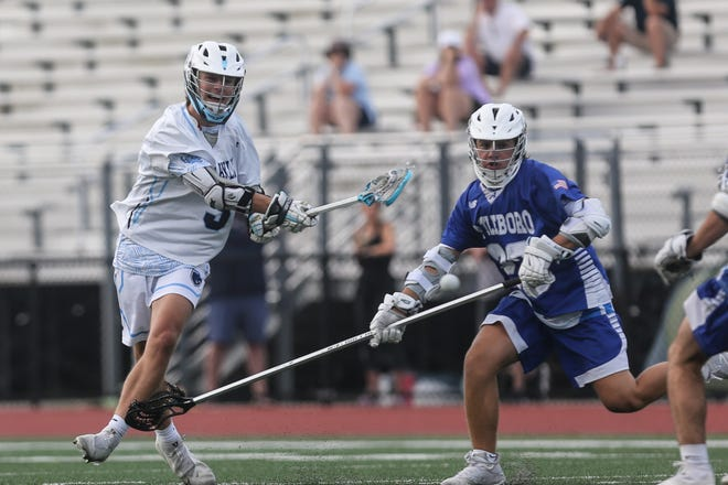 Franklin High sophomore Luke Davis shoots and scores during the boys lacrosse game against Attleboro at Franklin High School on Jun. 09, 2021.