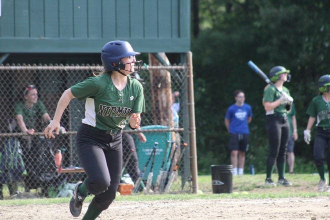 Nipmuc junior shortstop Lucie Nicholson runs to first as she hits a fly ball to center in the Warriors', 8-4, win over North Middlesex on Wednesday, June 9, 2021 at Nipmuc Regional High School.