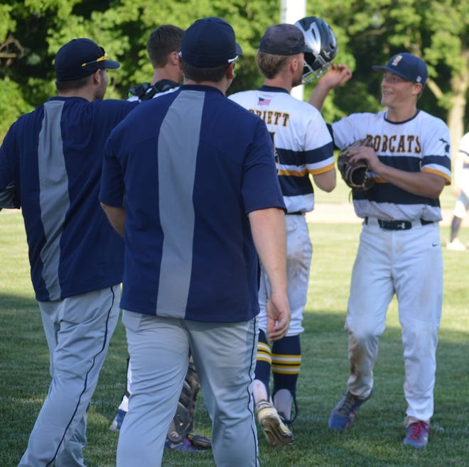 Levi Hillard (right) is congratulated by teammate Eric Parriett after Whiteford beat Plymouth Christian 9-2 in the Division 4 Regional semifinals Wednesday.