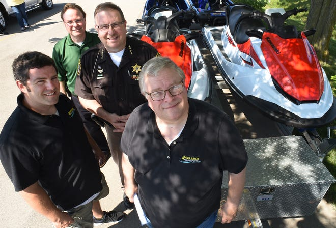 Tim and Sean Jackson, owners of River Raisin Powersports, are suppling two Kawasaki Jet Skis to the Monroe County Sheriff's Office, represented by Sheriff Troy Goodnough and Chief Deputy Dave Buchko.