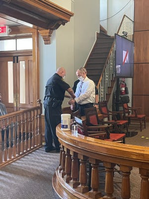 """Kenny W. McBride is handcuffed shortly after a jury found him guilty of first degree murder and mutilation of a corpse in the 2020 death of Cecilia """"Nickie"""" Gibson, 79. McBride will be sentenced Aug. 19."""