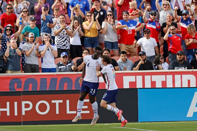 United States forward Daryl Dike (24) celebrates his first-half goal with forward Brenden Aaronson (11) during a 4-0 win against Costa Rica on Wednesday night in Sandy, Utah.