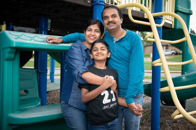 """Oklahoma Medical Research Foundation scientist Indranil Biswas, right, said getting a COVID-19 vaccine was part of his """"responsibility as a father."""" Biswas is pictured with son Imon, 7, and wife Monalisa Choudhury, who also is an OMRF scientist."""