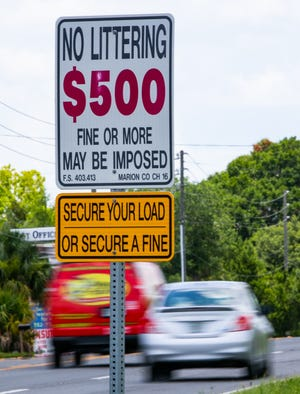 A sign warns motorists about the $500 fine for littering on SE Maricamp Road in Silver Springs Shores.